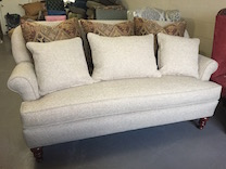 tight back sofa with throw pillows